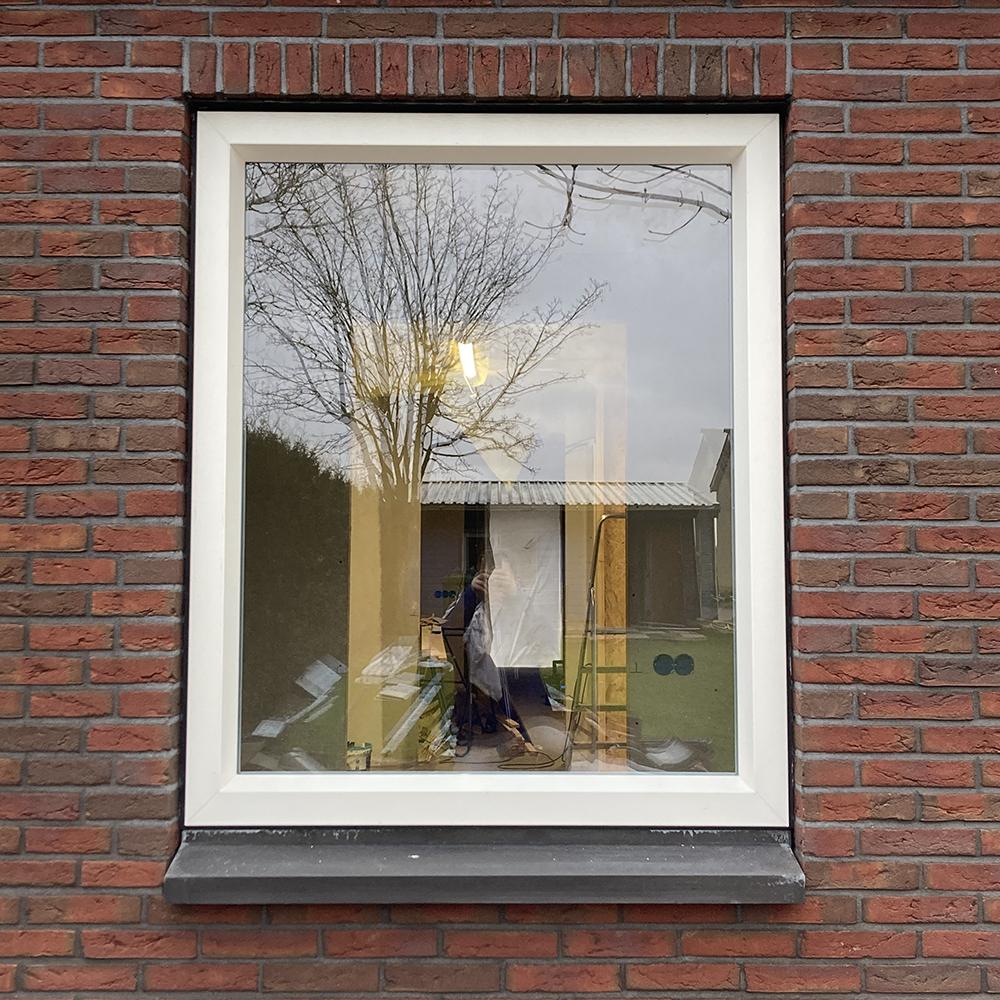Kunststof raam met houtnerf folie